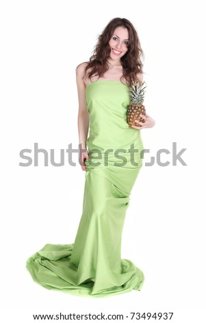 Young and healthy girl with pineapple in her hands isolated on white. Studio shot. - stock photo