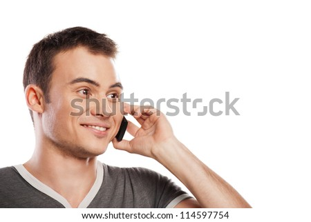 Young and healthy man answering the phone against a white background