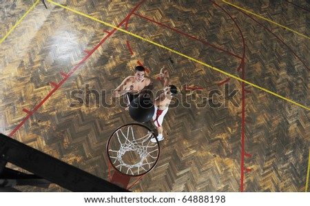 young and healthy people man have recreation and training exercise  while play basketball game at sport gym indoor hall - stock photo