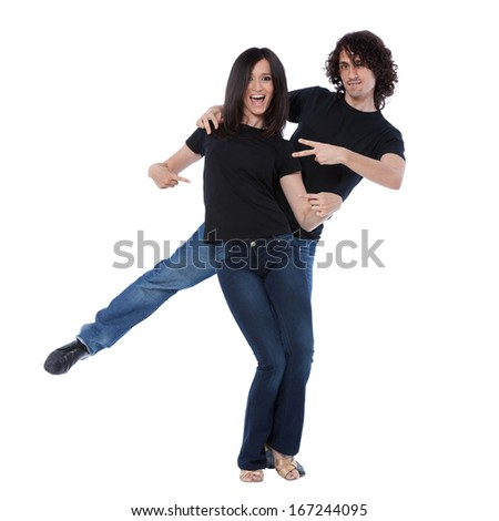 Young and joyful couple playing around with black shirts. Can be used with some text applied on them.