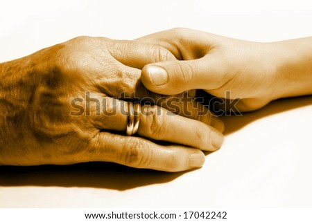 Young and old hand together - stock photo