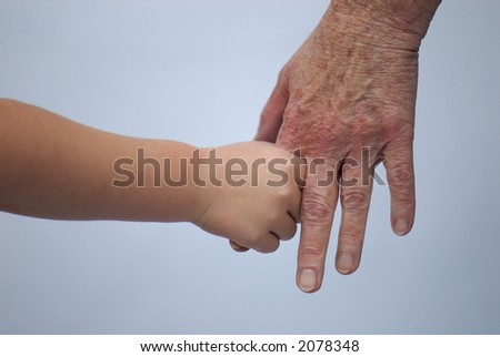 young and old holding hands - stock photo