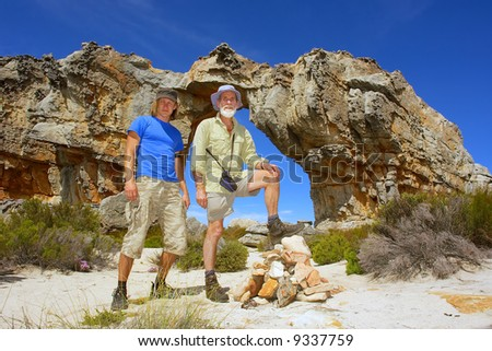 Young and old man in mountains. Shot in Wolfberg Mountains, Cederberg, Western Cape, South Africa.