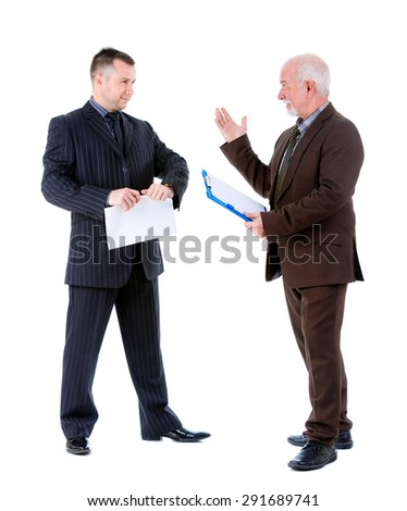 Young and old senior two businessman in suits argue and swear. Isolated on white background, Negative human emotion, facial expression - stock photo