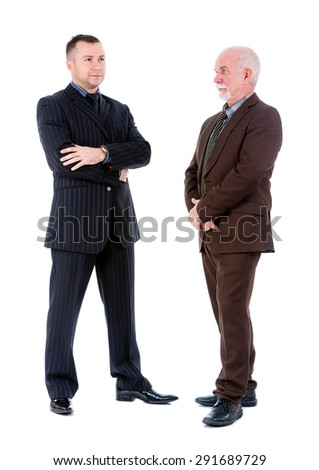Young and old senior two businessman in suits posing. Isolated on white background, Negative human emotion, facial expression - stock photo