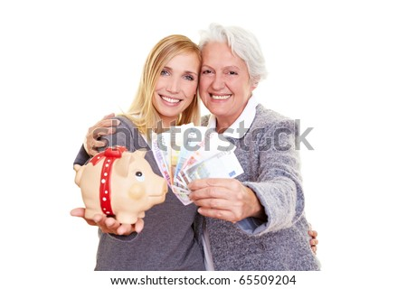 Young and old woman holding Euro money and a piggy bank - stock photo