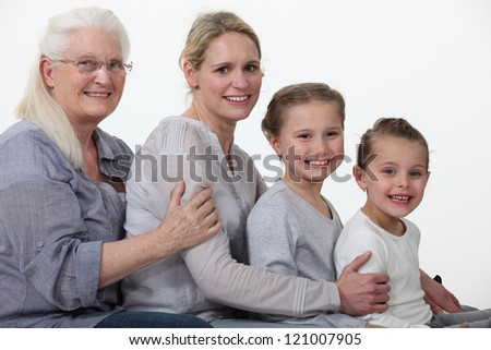 young and older female foursome - stock photo