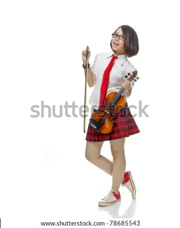 Young and pretty teenager school girl poses with violin, isolated background - stock photo