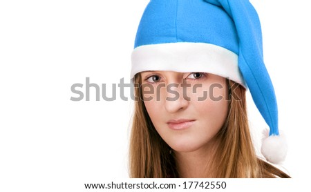 Young and pretty woman with sad eyes, posing in blue santa's cap. Isolated over white