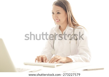 Young and professional doctor working in office - stock photo