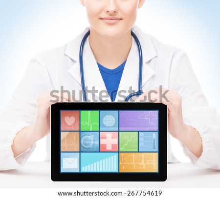 Young and professional medical doctor showing a tablet pc. Tile design and technology concept.  - stock photo