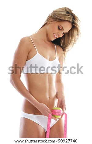 Young and sexy blond measuring her waist isolated over white background - stock photo
