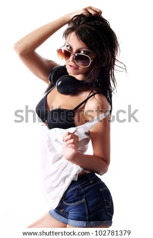Young and sexy oiled girl with headphones