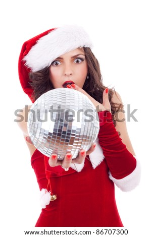 Young and sexy woman with disco ball wearing santa's suit