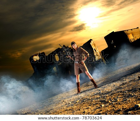 Young and sexy woman with the machine gun in apocalyptic landscape - stock photo