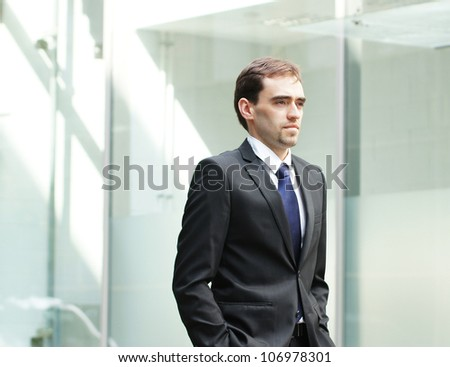 Young and smart business man - stock photo
