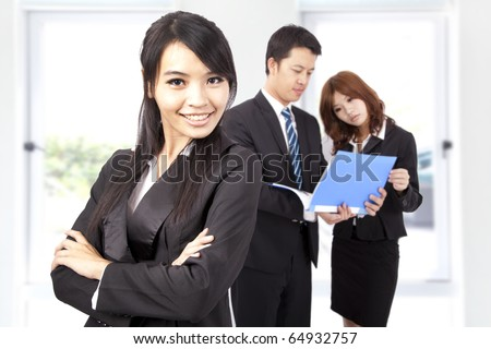 Young and smiling Business woman in an office - stock photo