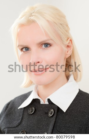 Young and smiling portrait from businesswoman - stock photo