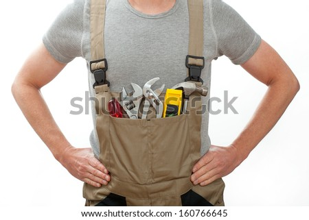 Young  and strong handyman rady to work on white isolated background