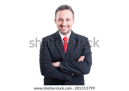 Young and successful business man with arms crossed his chest