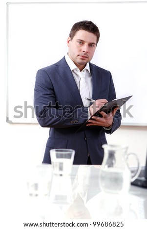 Young and successful businessman in his office