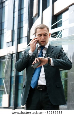 Young and successful businessman on the phone - stock photo