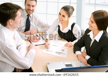 Young and successful businessteam in an office - stock photo