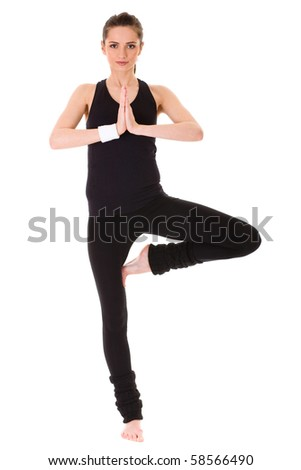 young and very attractive female exercise, trying to balance on just one leg, studio shoot isolated on white