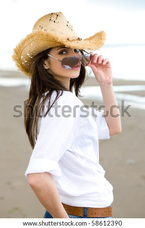 young and very attractive young woman in straw hat and sunglasses relax at the beach - stock photo