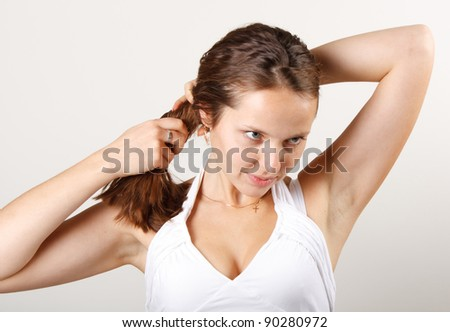 young and very beautiful girl on white background