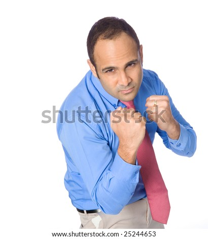 Young angry businessman with fist ready to fight. - stock photo