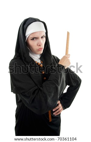 Young, angry Catholic nun lwith ruler in hand on a white background - stock photo