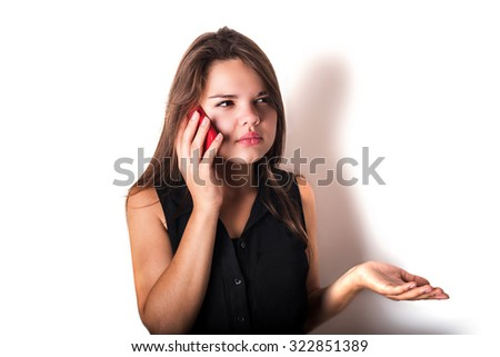young angry caucasian female speaking on phone. Female is angry, she talking on phone isolated on white - stock photo