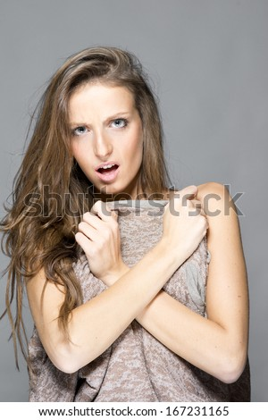 Young angry cute woman embarrassed - stock photo