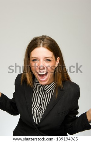 Young angry desperate business woman screaming on white background