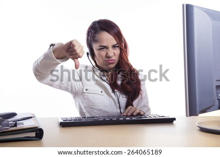 Young angry girl with headset in the office - stock photo
