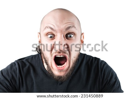 young angry man is screaming, isolated - stock photo