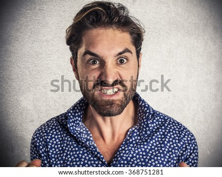 Young angry man screams - stock photo