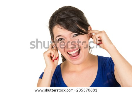 young angry unhappy girl covering ears isolated on white - stock photo