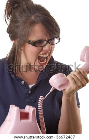 Young angry woman yells into the telephone; isolated on a white background - stock photo