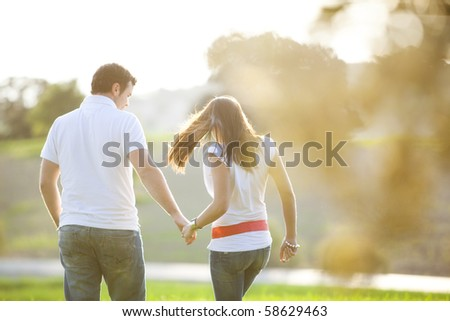 Young anonymous couple taking a walk on nature - stock photo