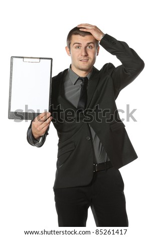 Young anxious businessman holding his head with hands. Worried businessman holding blank board, isolated on white background - stock photo