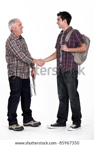 Young apprentice meeting his new boss - stock photo