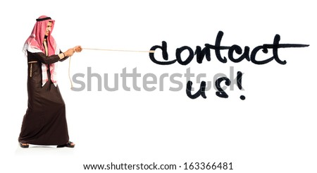 Young Arab pulling a rope with inscription Contact Us isolated on white background - stock photo
