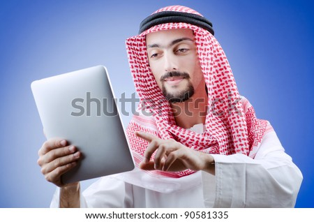 Young arab with tablet computer - stock photo