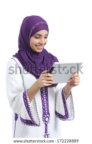Young Arab woman reading a tablet, isolated on a white background. - stock photo
