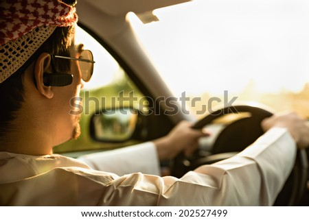 Young Arabian Businessman Driving The Car - stock photo