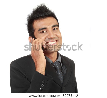 Young arabic businessman talking on the phone - stock photo