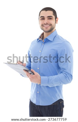 young arabic man writing something on clipboard isolated on white background - stock photo