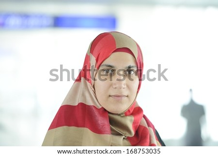 Young Arabic woman traveling at the airport - stock photo